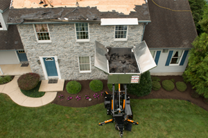 roofers cleaning debris using equipter